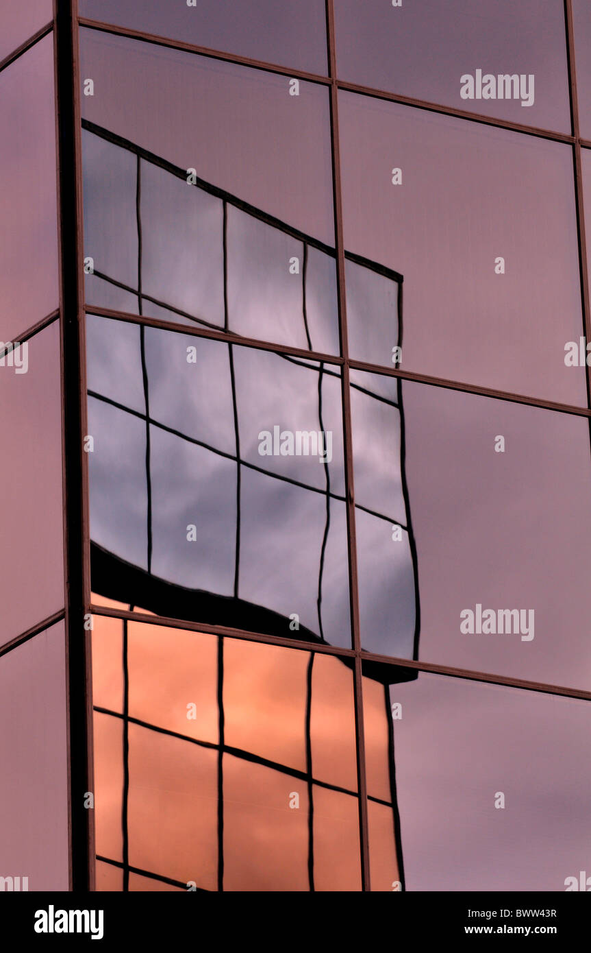 Reflection of buildings in mirrored glass - Stock Image