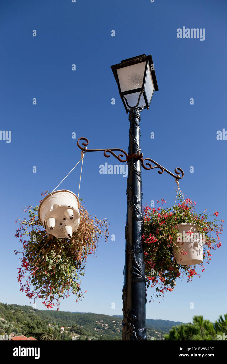 Quirky Hanging Baskets Hang From A Lamp Post In Montauroux Var