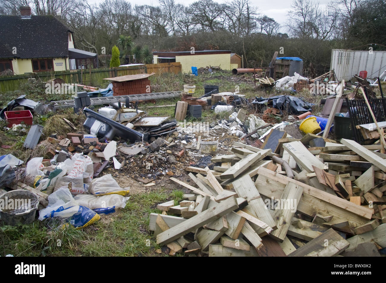 Chaos Untidy Disorganised Mess Lazy Garden Backyard Junk Rubbish Builders  Milford On Sea Hampshire England UK Pollution Pollute