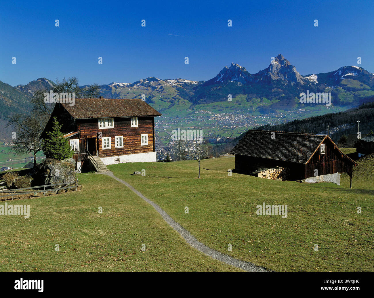 look glance on big great and small little myths houses homes Switzerland Europe Schwyz mountain Seelis - Stock Image