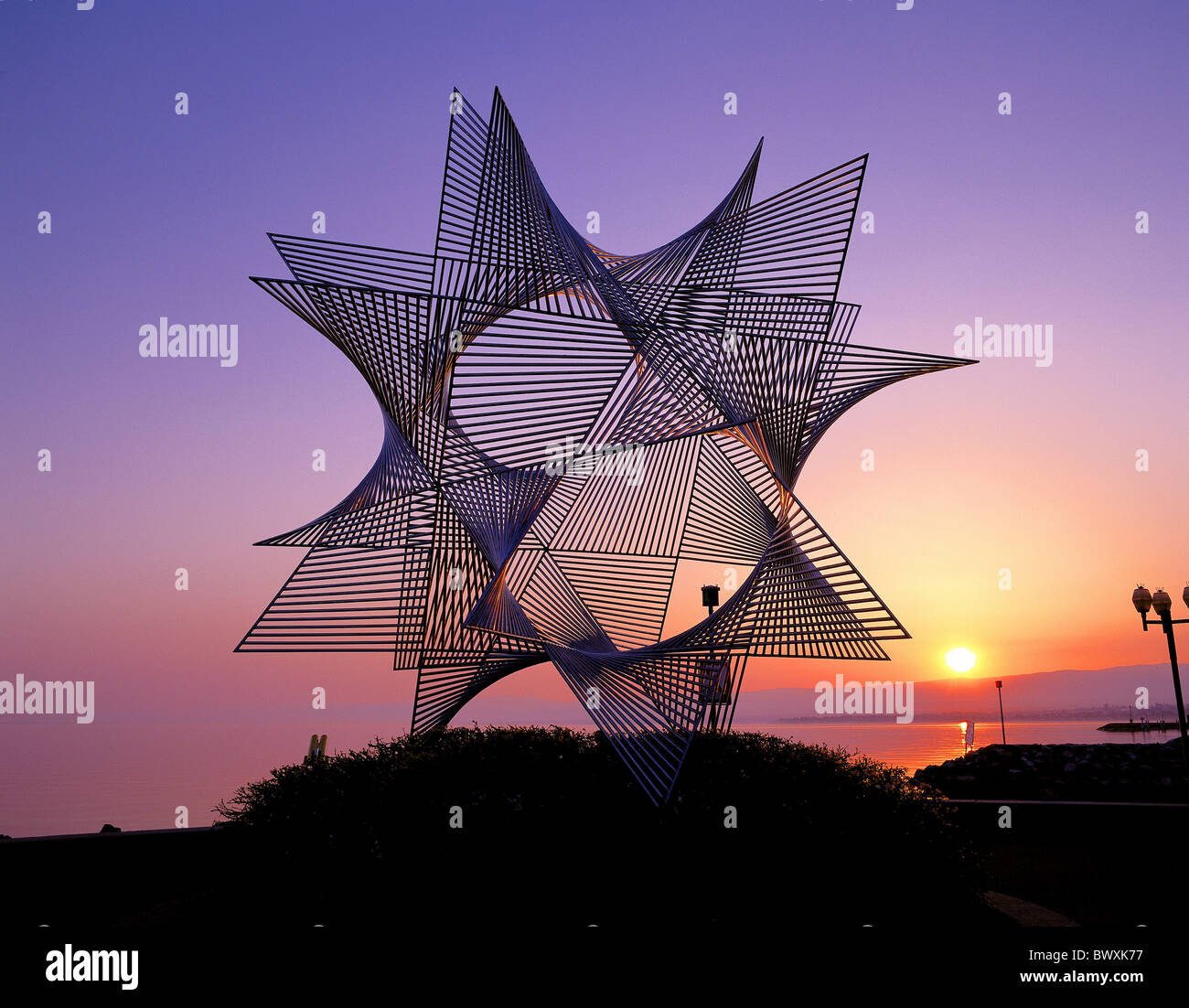 sculpture Switzerland Europe modern star-shaped metal sundown lake sea Lausanne Olympia museum - Stock Image