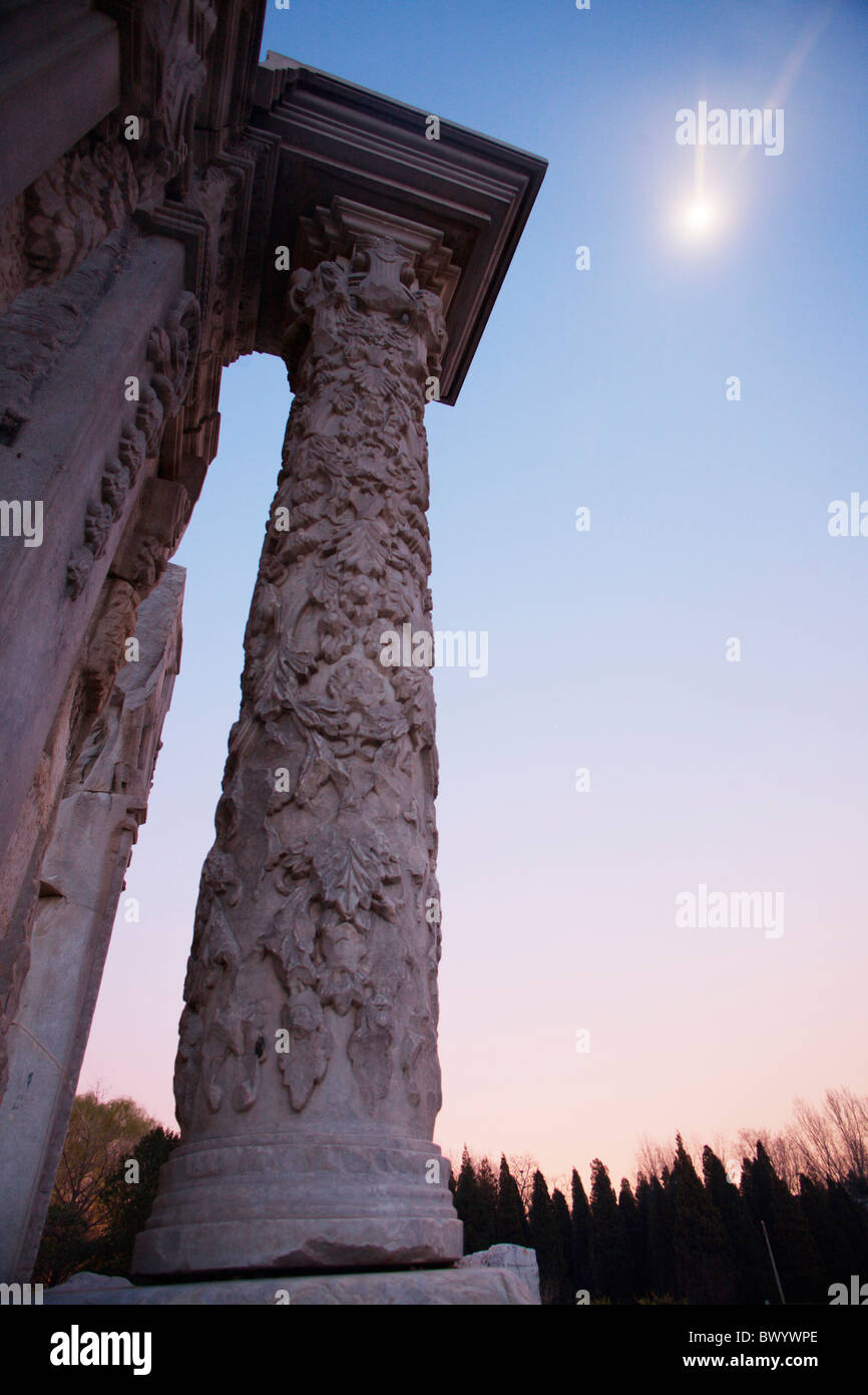 Ruin of European style palaces in Yuanmingyuan Park at dusk, Beijing, China - Stock Image