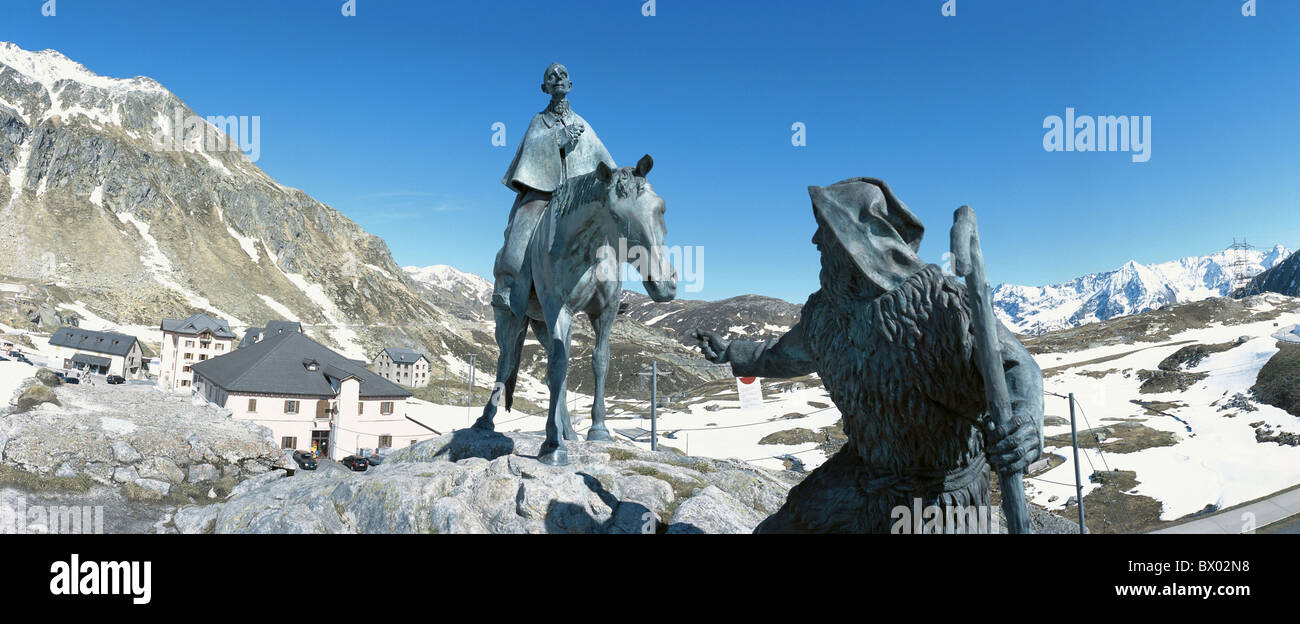 alpine Alps mountains bronze sculpture Gotthard Switzerland Europe Gotthardpass panorama pass snow Switze - Stock Image