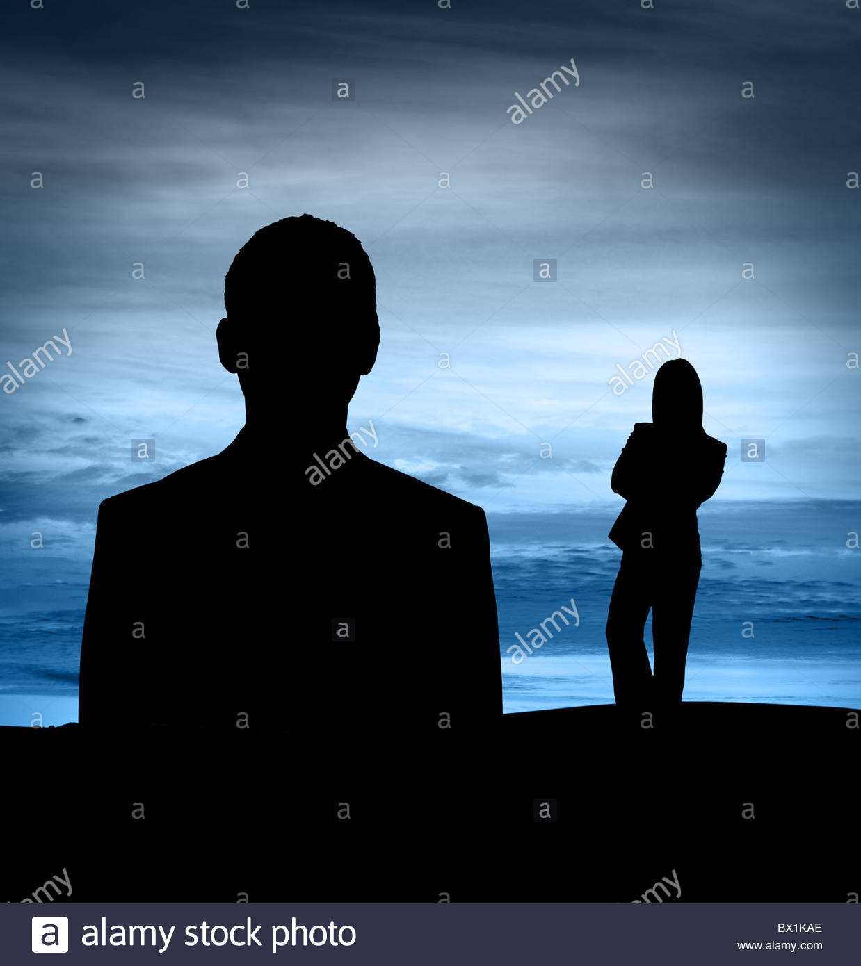 Business man and woman silhouette - Stock Image