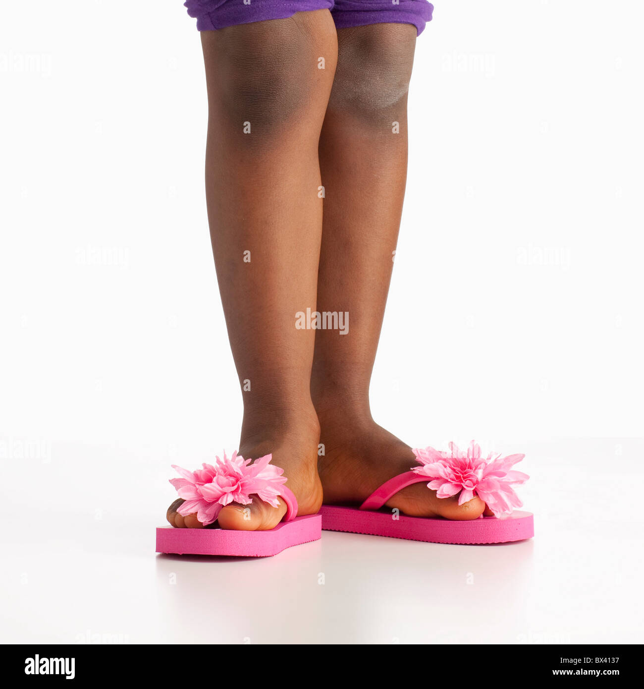 A Girl Wearing Flip Flops With Pink Flowers Stock Photo 33280107