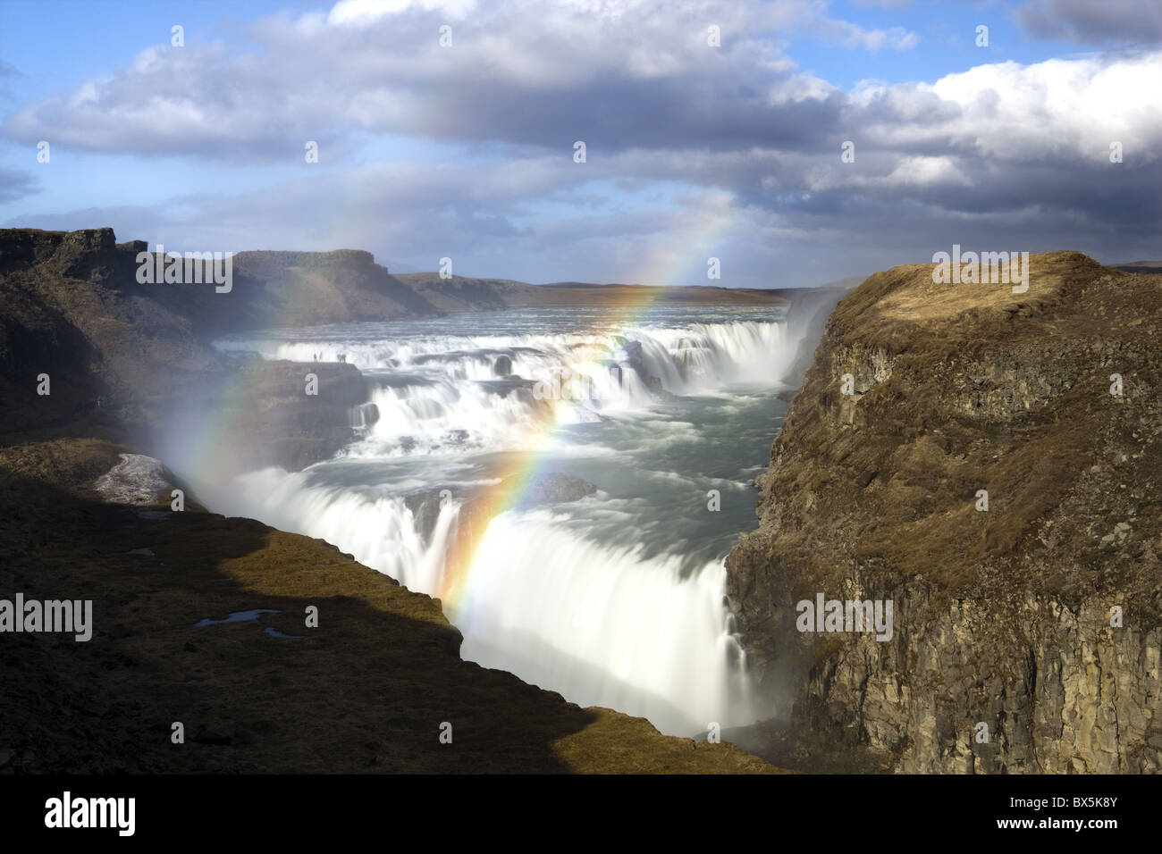Gullfoss, Europe's biggest waterfall, with rainbow created by spray from the falls, near Reykjavik, Iceland, - Stock Image