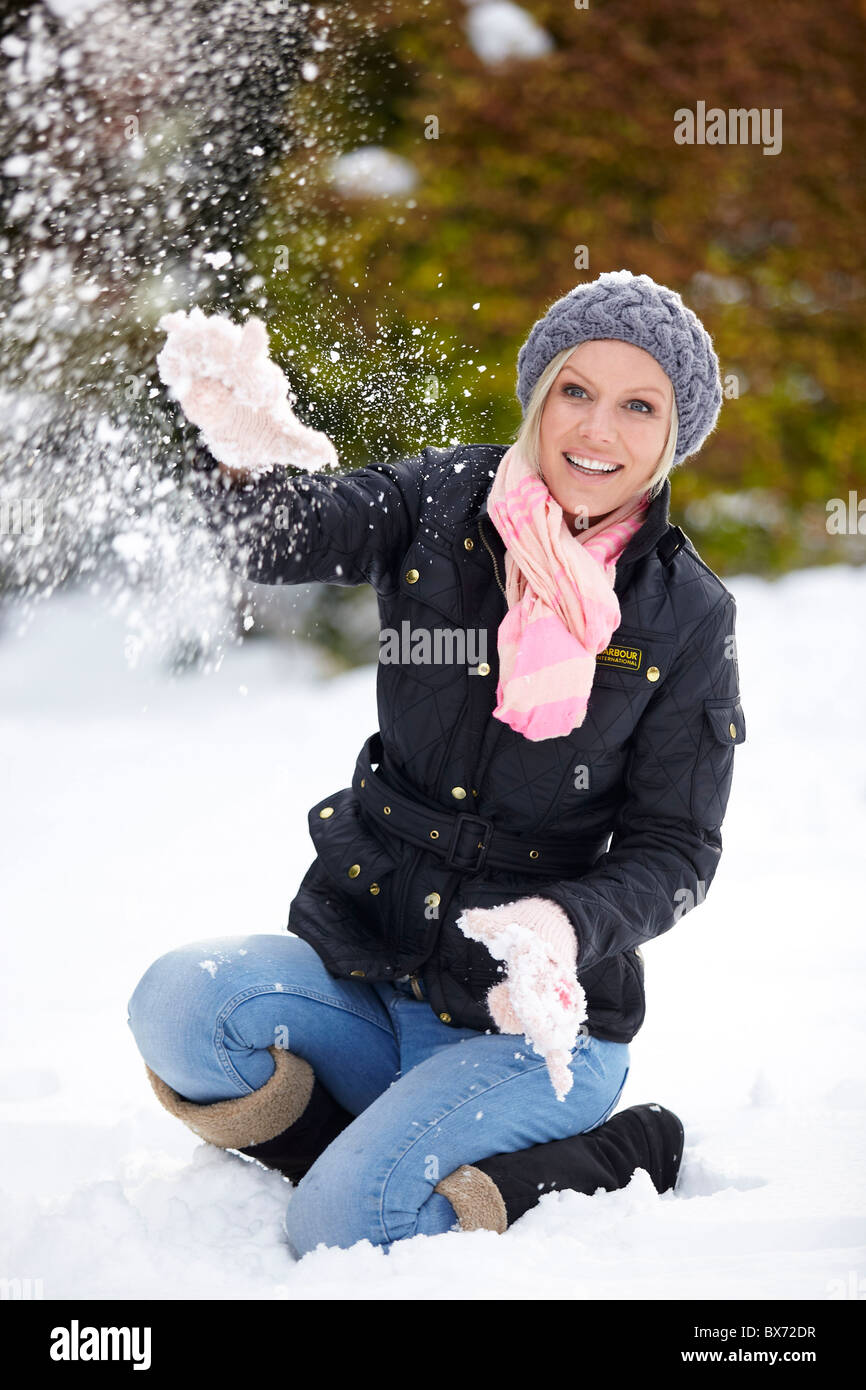 Woman in snow having fun - Stock Image