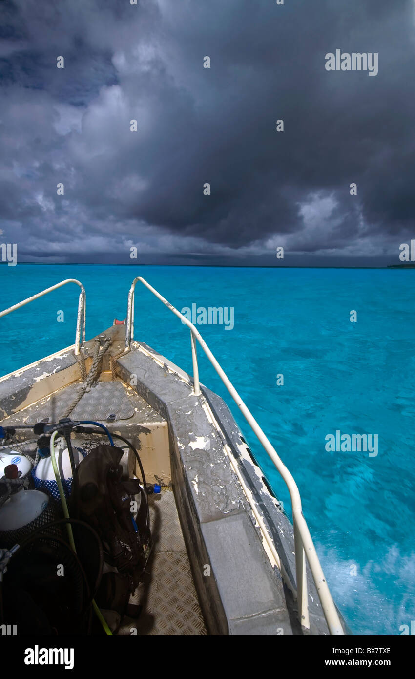 Heading to the dive site in the monsoon, Cocos Keeling atoll lagoon, Indian Ocean - Stock Image
