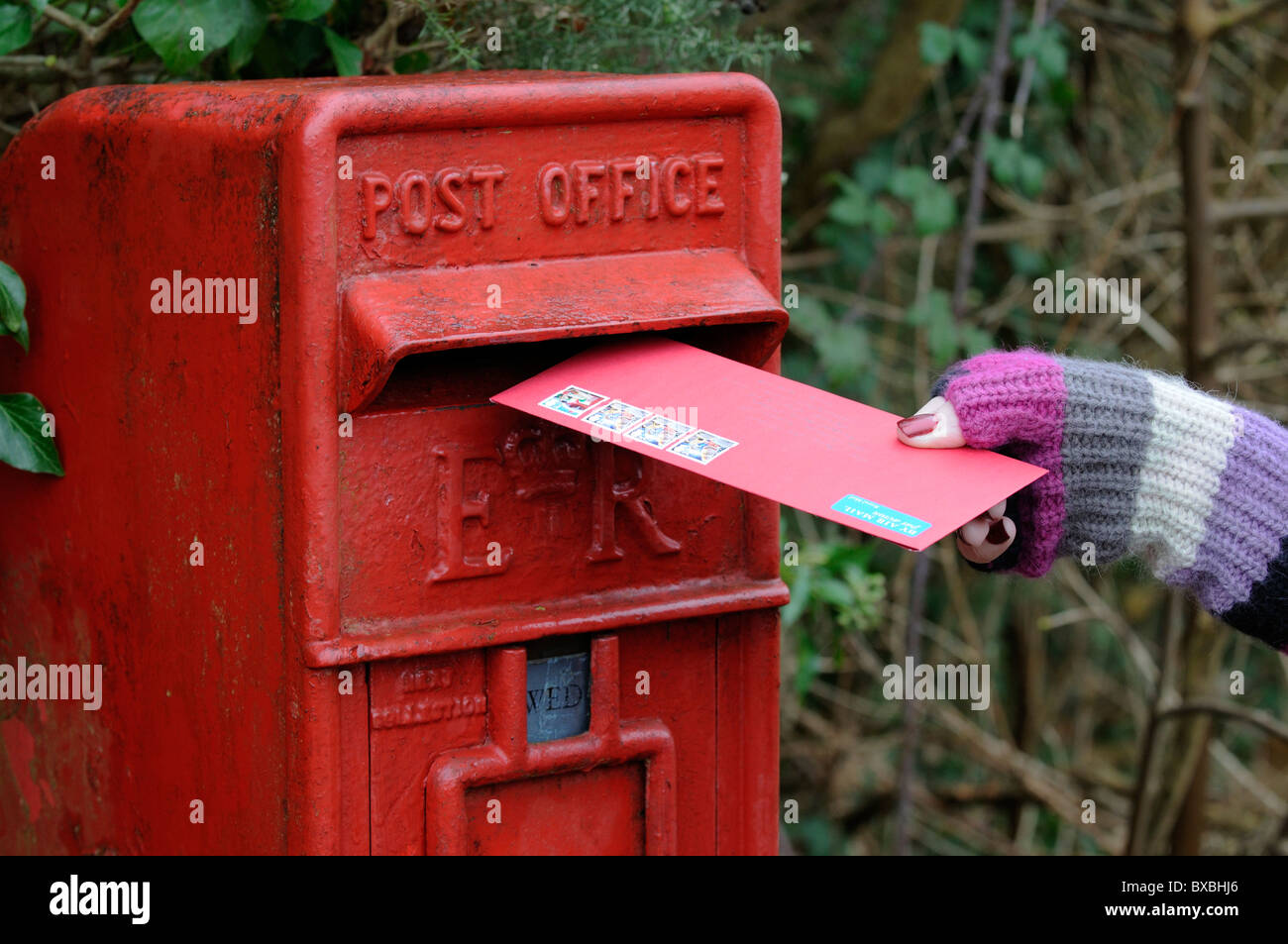 Woman posting christmas greetings cards in a royal mail letterbox woman posting christmas greetings cards in a royal mail letterbox m4hsunfo