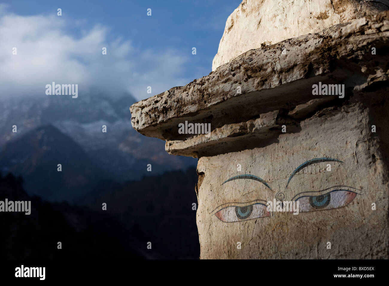 The eyes of a trail side stupa keep watch over travelers in Nepal. - Stock Image