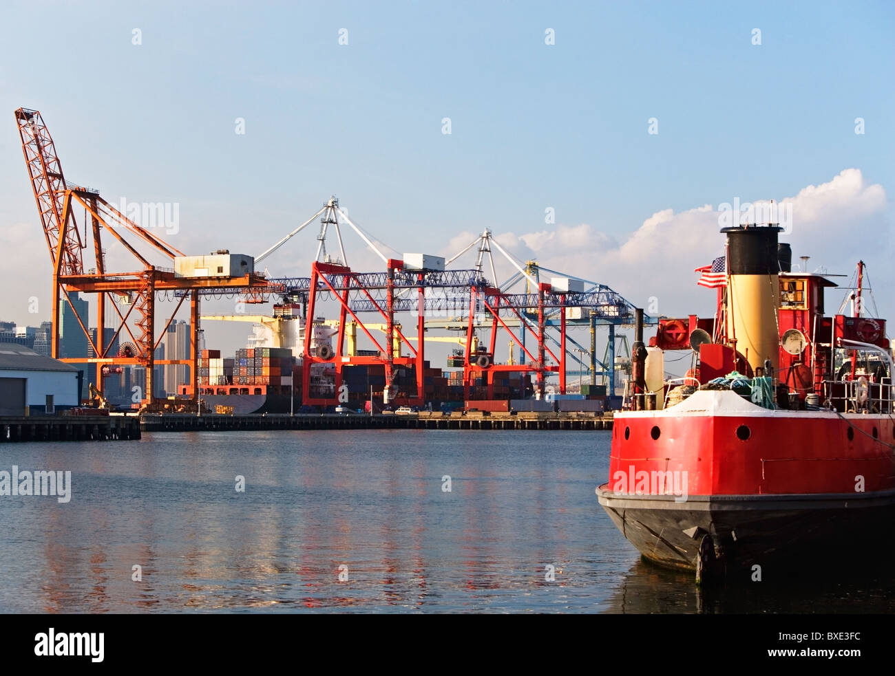 Cargo ships and container crane - Stock Image