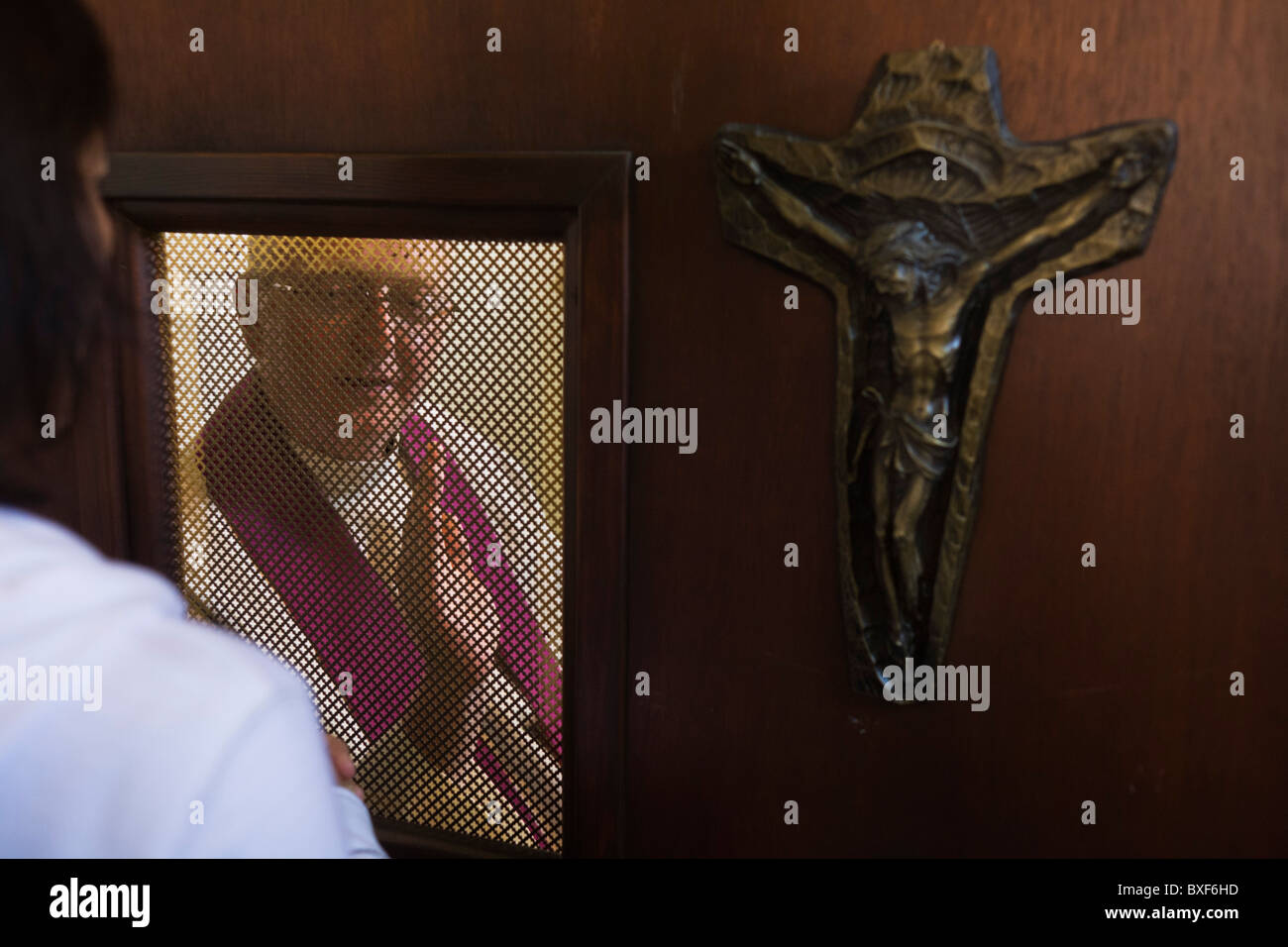confessional-between-penitent-and-priest