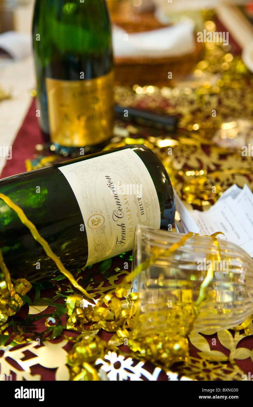 empty-champagne-bottles-and-glasses-after-a-christmas-party-BXNG30.jpg