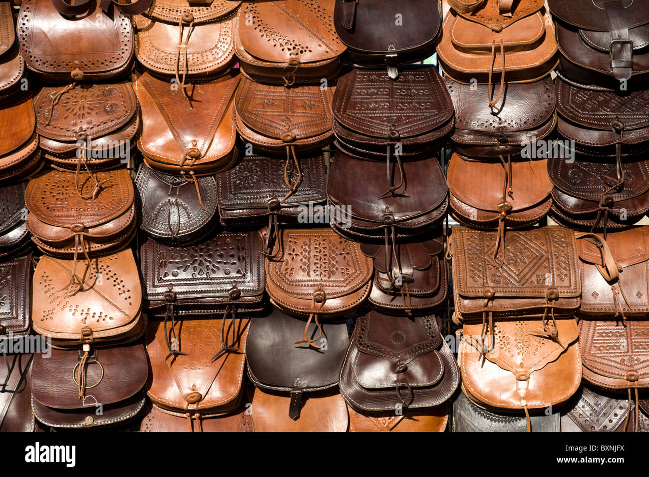 Handmade leather bags on market stall, Spain - Stock Image