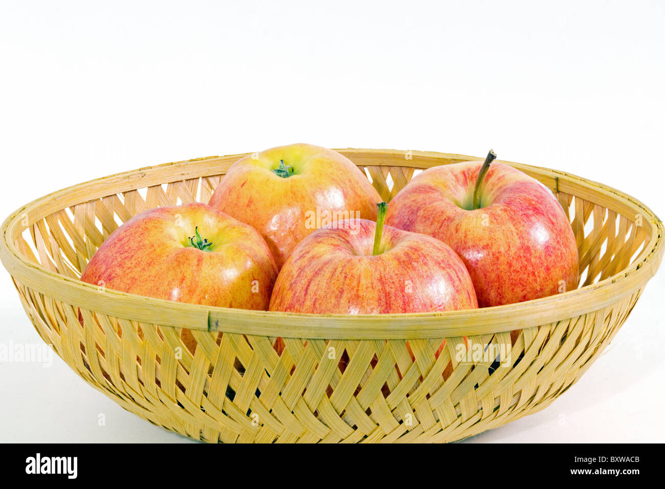 basket with four apples stock photo 33748411 alamy