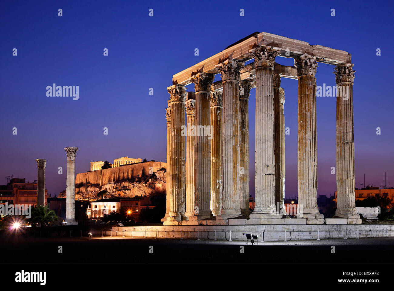 "The Temple of Olympian Zeus in the ""blue"" hour with Acropolis in the background. Athens, Greece Stock Photo"