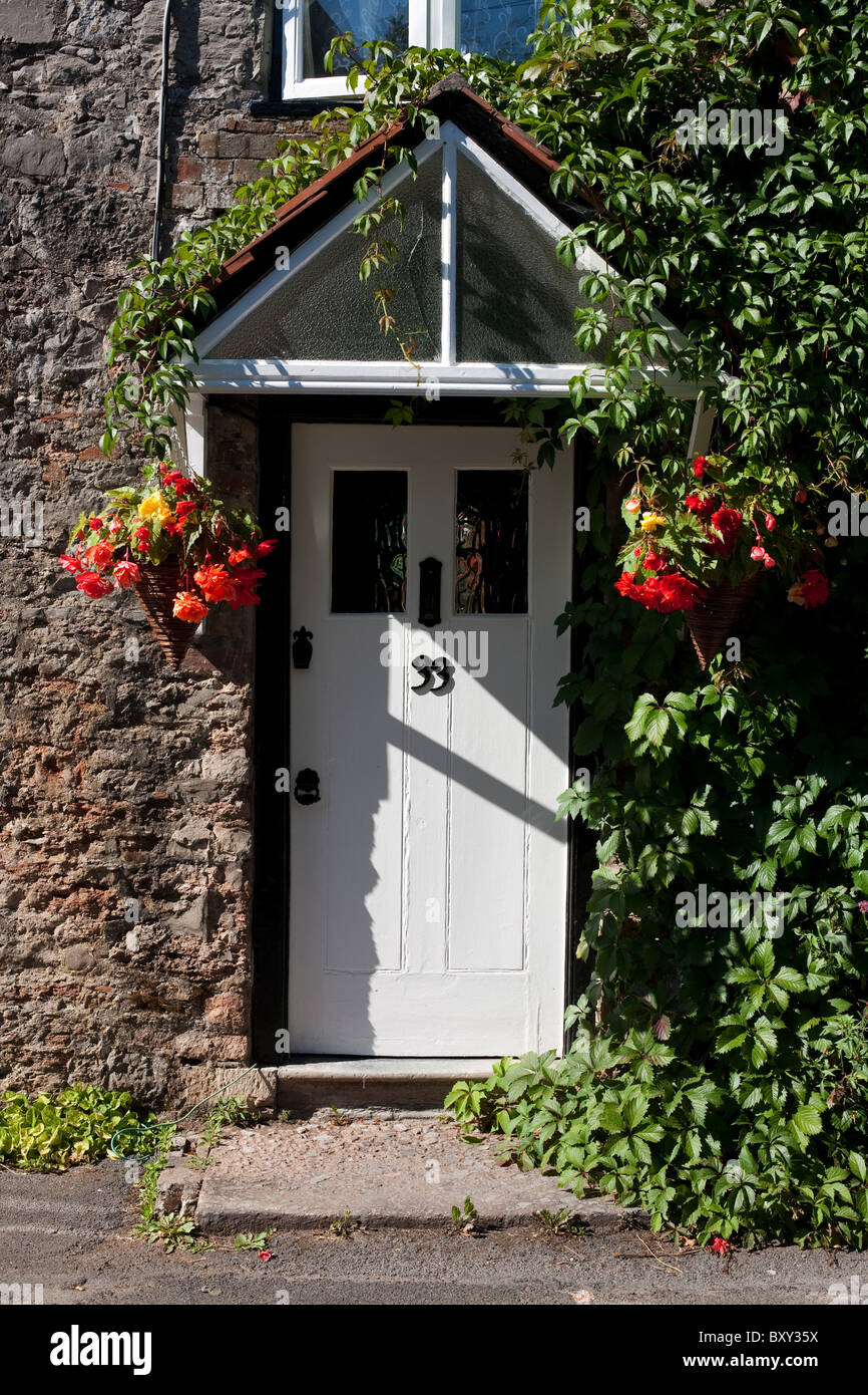 A white doorway with canopy and flowers in Cheddar Somerset. & A white doorway with canopy and flowers in Cheddar Somerset Stock ...