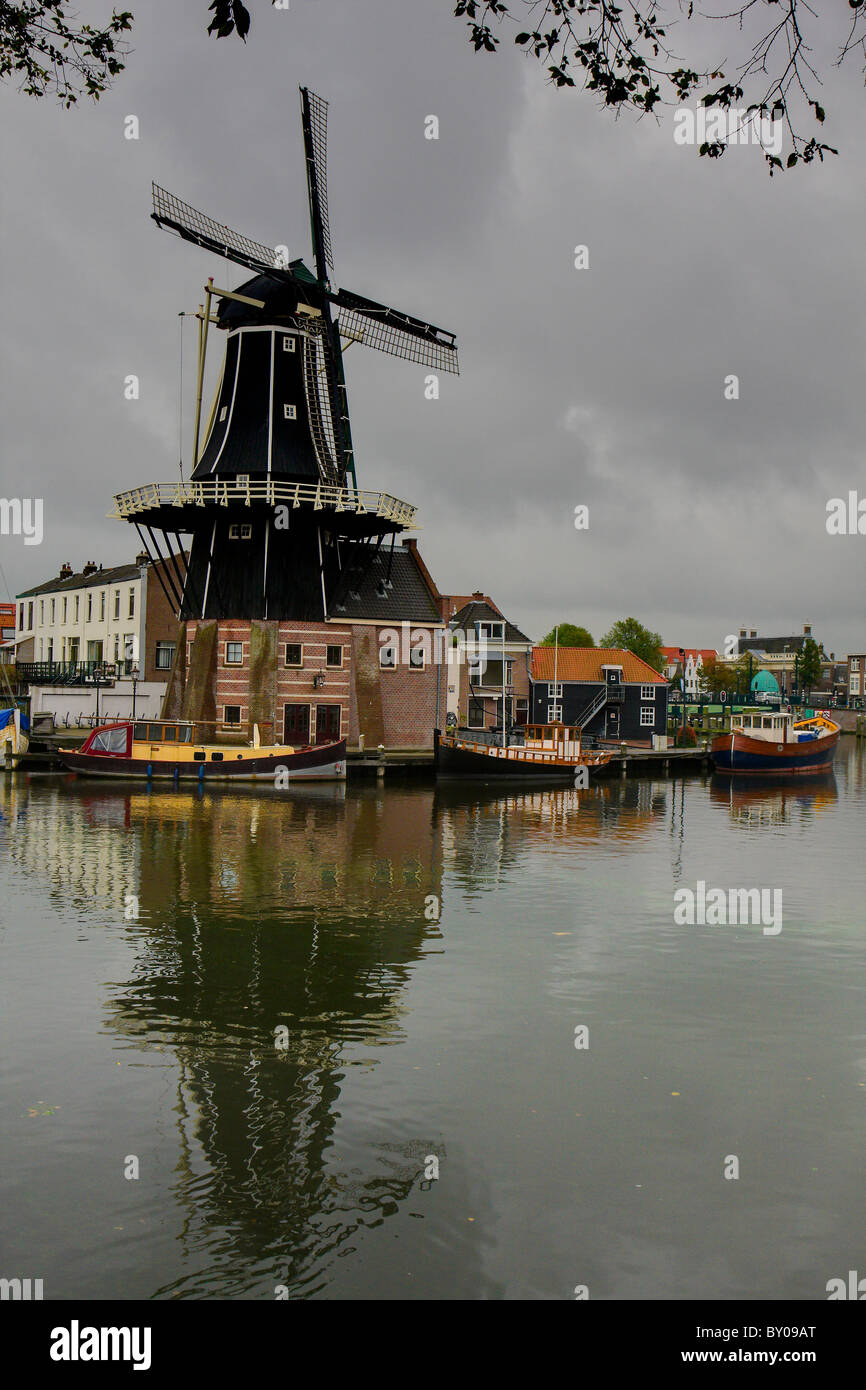 Windmill De Adriaan in Haarlem, Netherlands on a cloudy day - Stock Image
