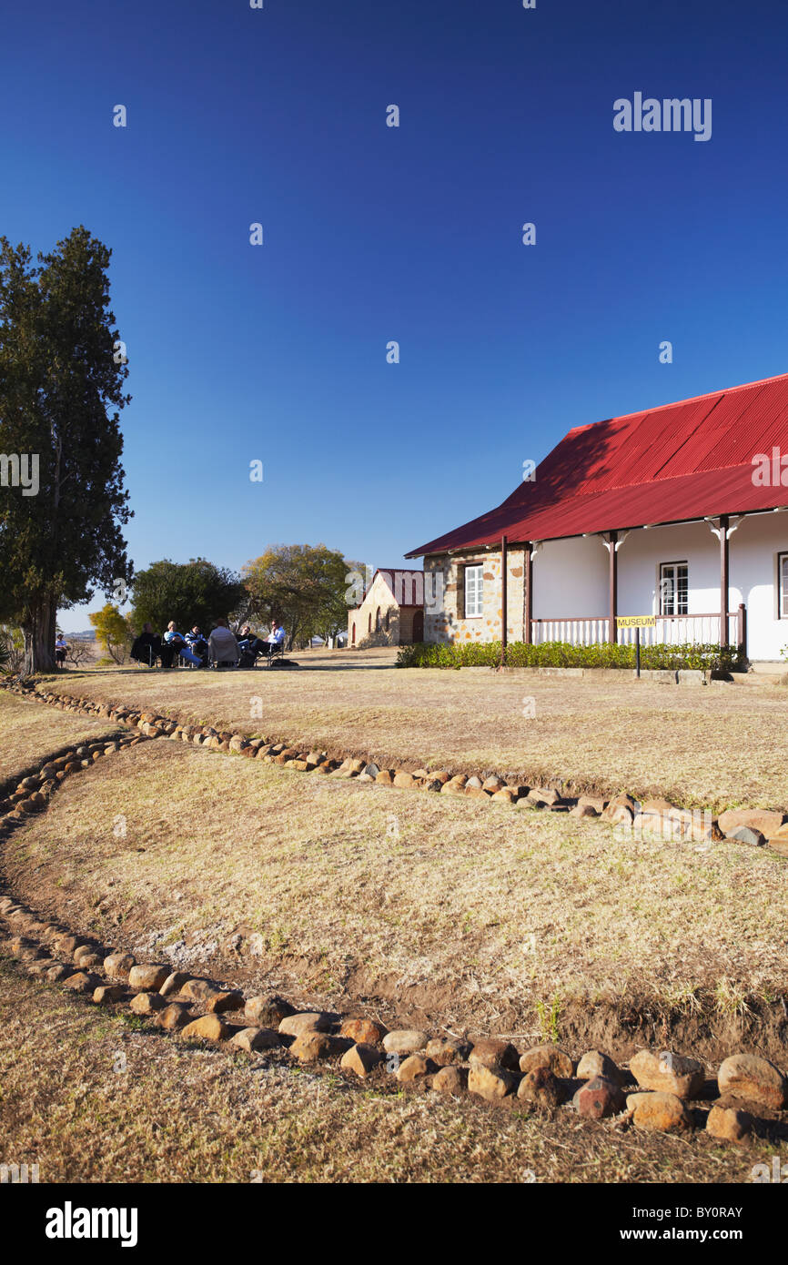 Tourists sitting outside museum at Rorke's Drift, Thukela, KwaZulu-Natal, South Africa - Stock Image