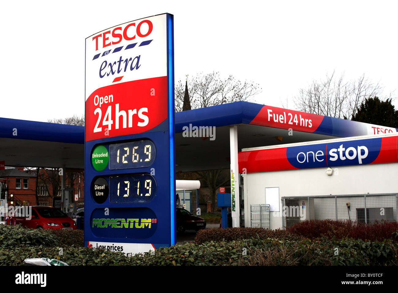 A Tesco Extra fuel station open 24hrs showing the petrol prices at the garage after the VAT rise Stock Photo