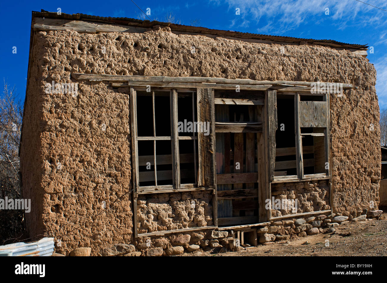 Old adobe building in taos new mexico stock photo for Adobe house construction
