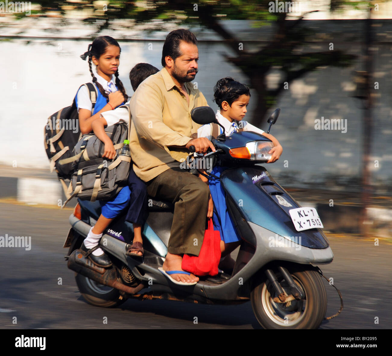 children-going-to-school-by-motorbike-in