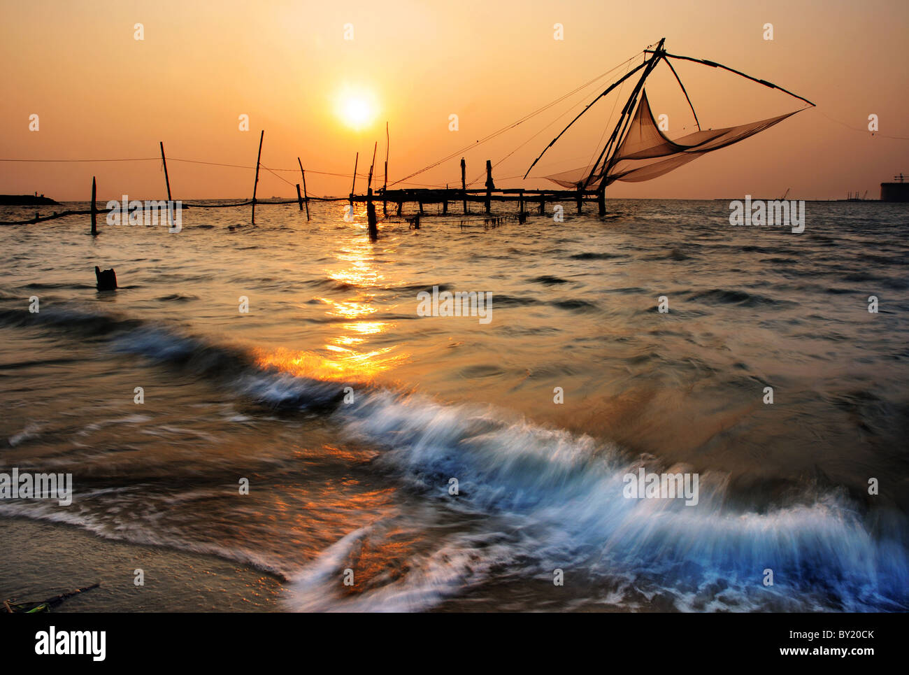 Sunset and the fishing nets at Kochin in south India Stock Photo