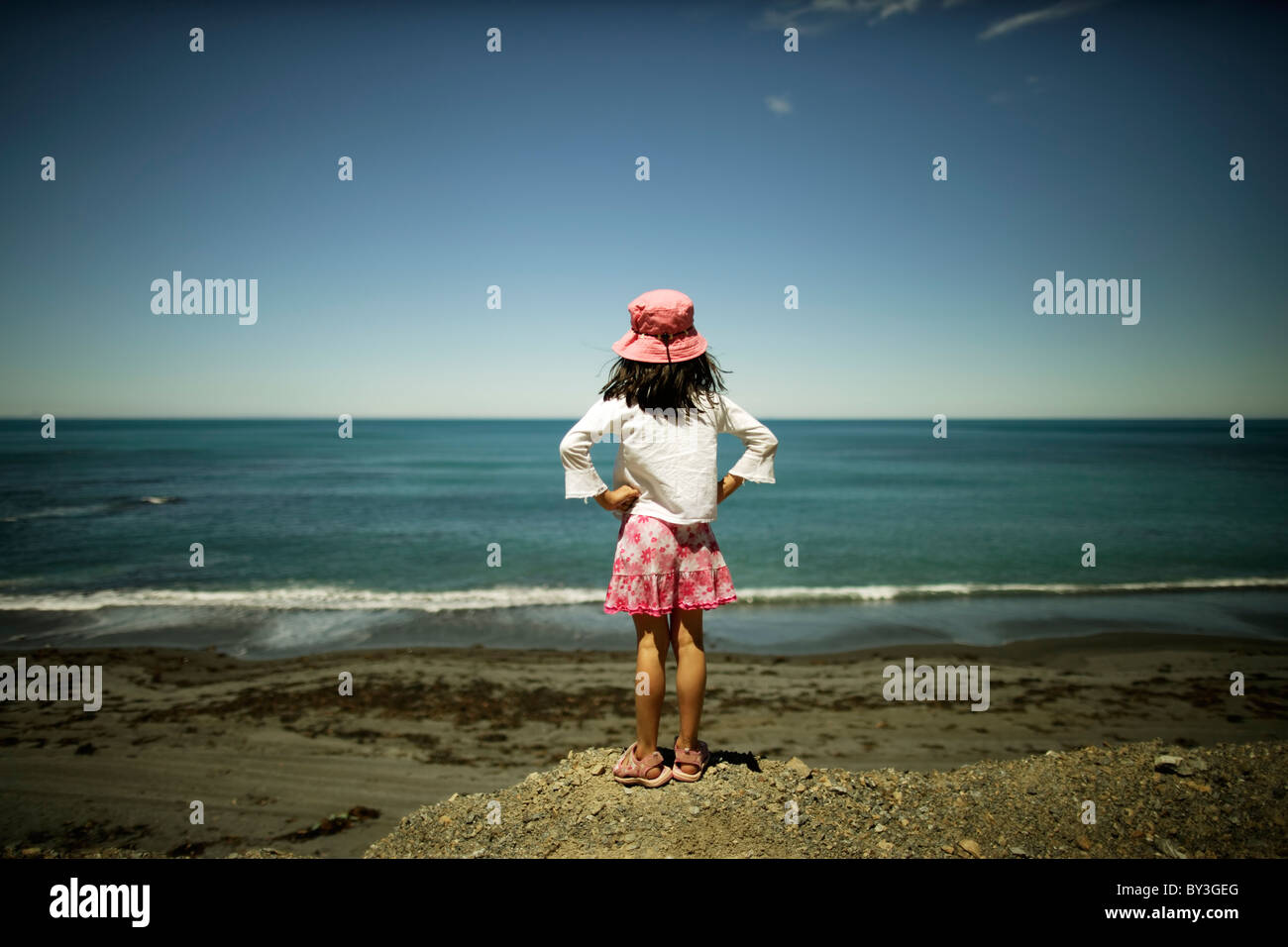 Girl looks at ocean, Wellington, New Zealand - Stock Image