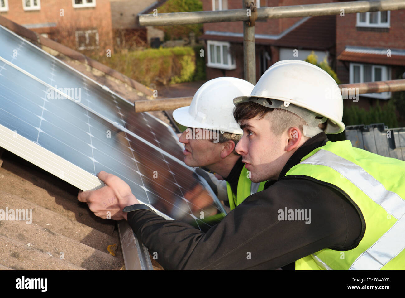 installing-photo-voltaic-solar-panels-on