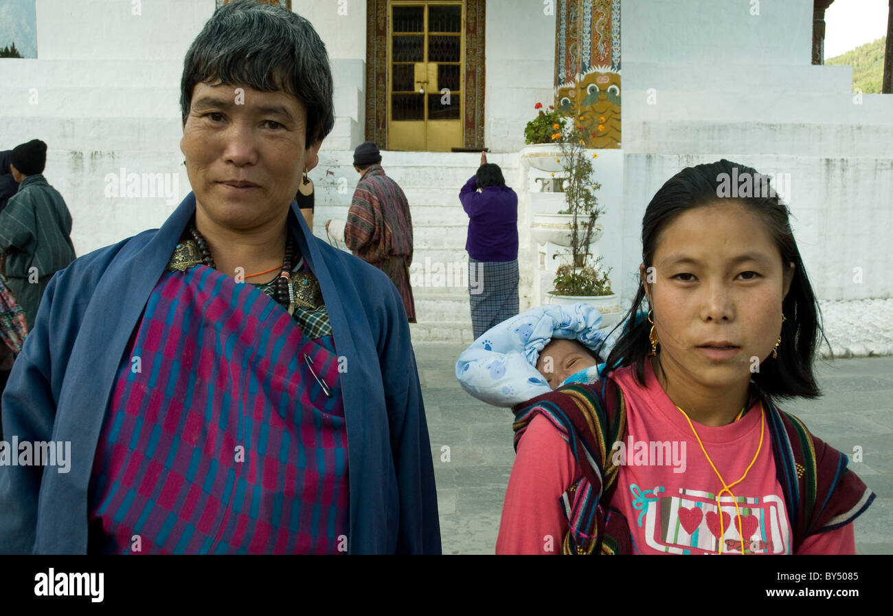 Three generations--a young mother, her baby and her own mother--are among pilgrims to the Memorial chorten near - Stock Image