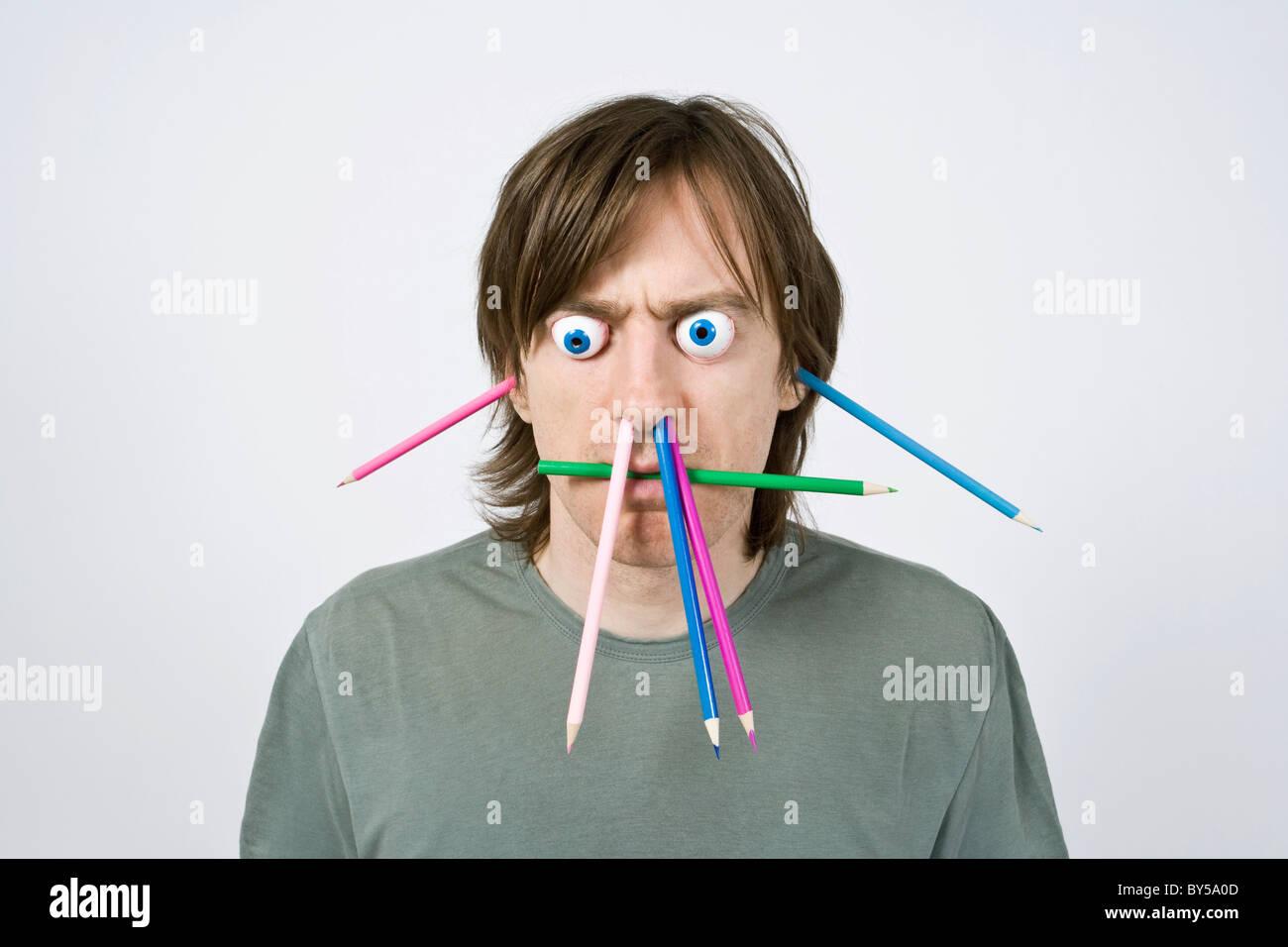 Bizarre man with pencils - Stock Image