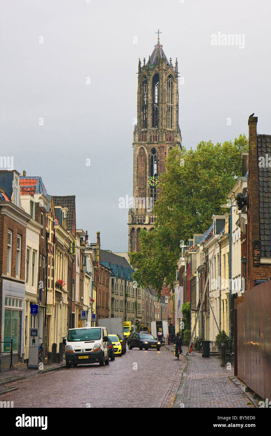 Utrecht, Netherlands city street with the Dom Tower in the background; gray overcast day - Stock Image