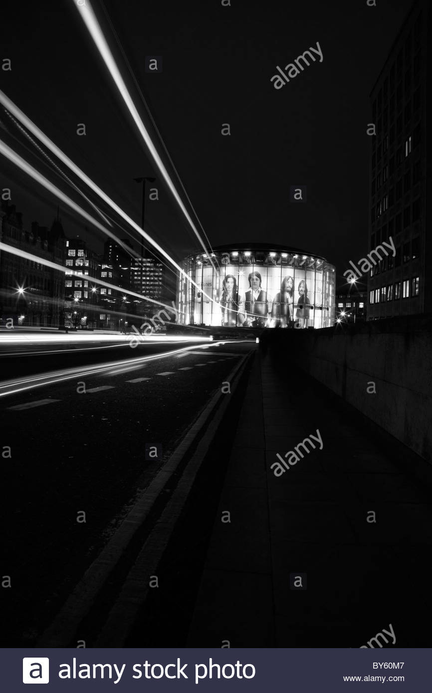 View of the iTunes Beatles billboard on the IMAX cinema taken from Waterloo Bridge, South Bank, London, UK - Stock Image