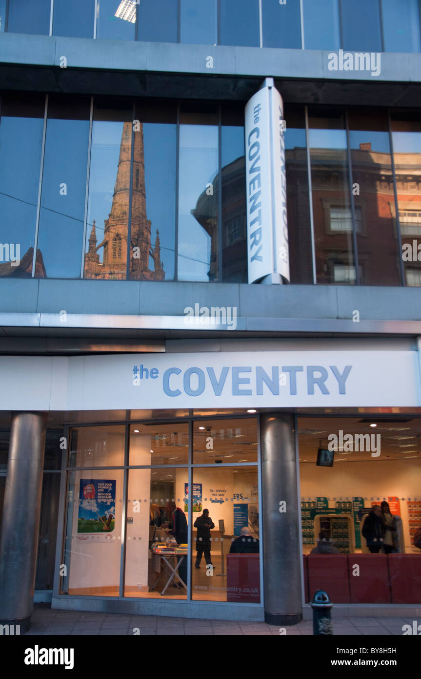 Coventry building society in Coventry with the cathedral spire reflecting in the glass. West Midlands, England. Stock Photo