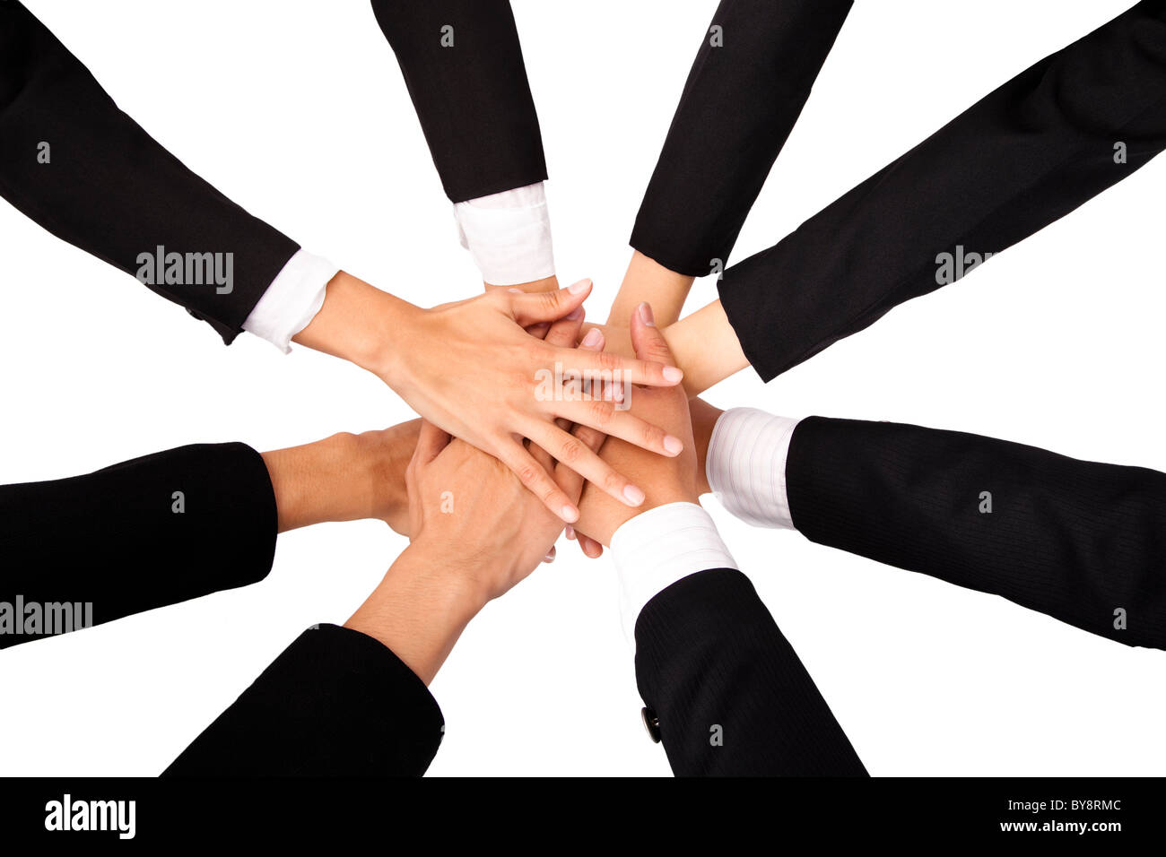 Teammate's Hands on top of each other. - Stock Image