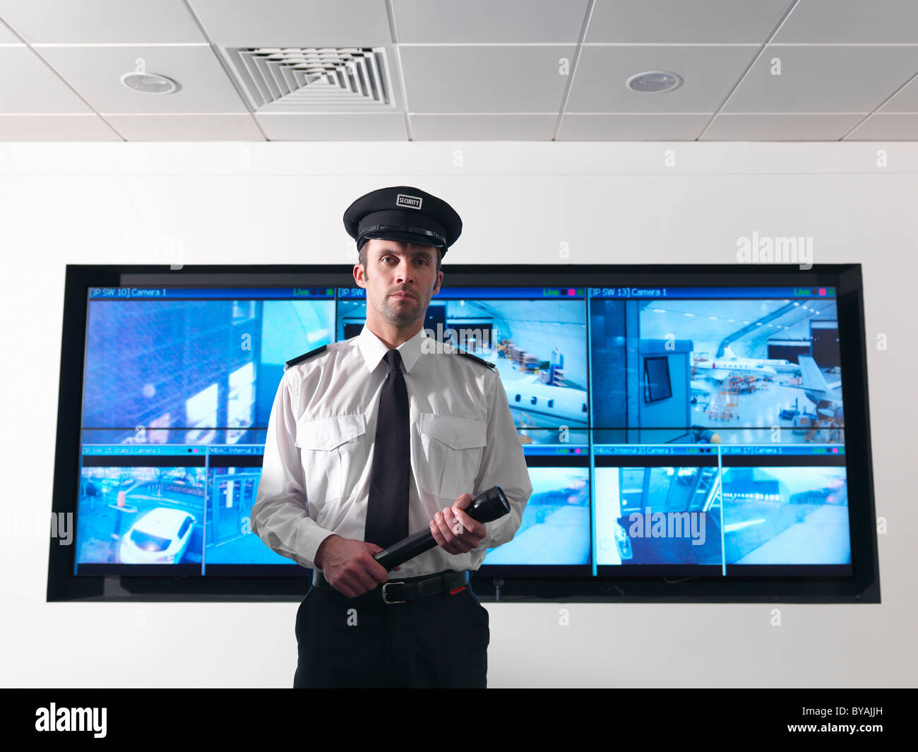 Security guard in control room - Stock Image