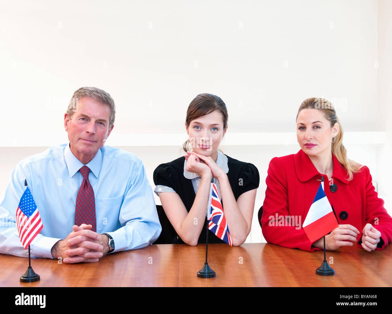 Three international business people - Stock Image
