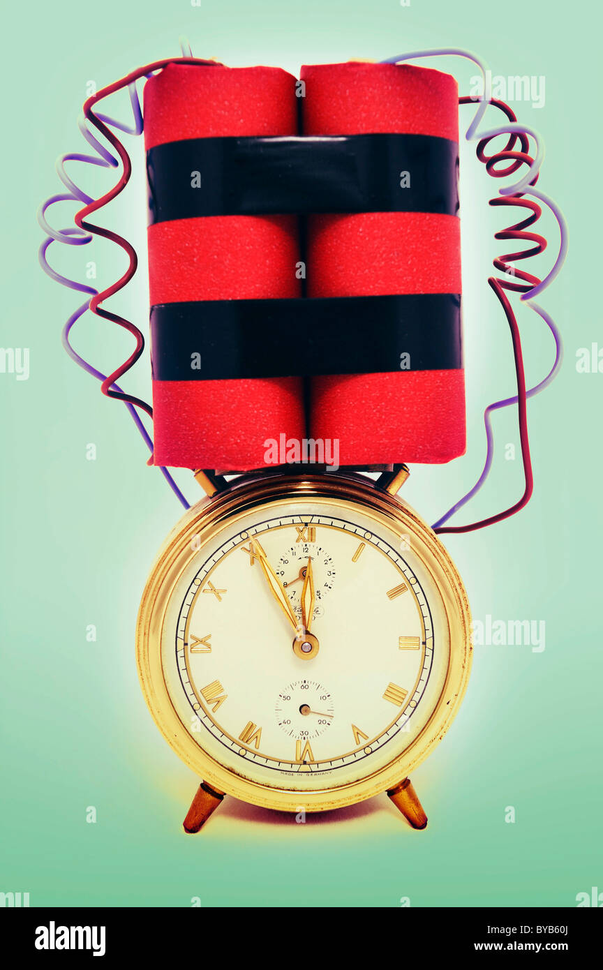 Time bomb, alarm clock with explosive device, symbolic image - Stock Image