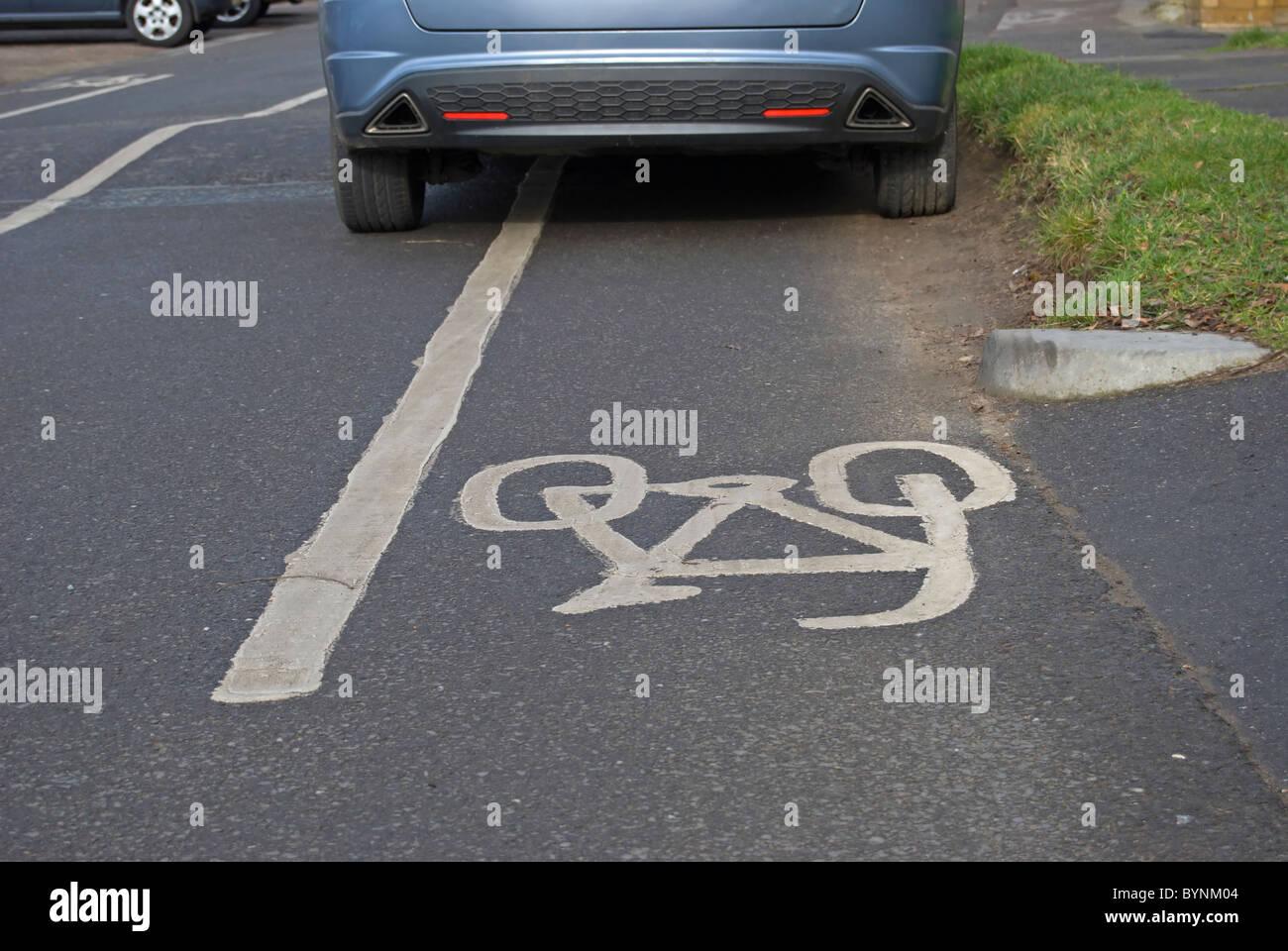 car parked in mandatory cycle lane, in ham, surrey, englandStock Photo