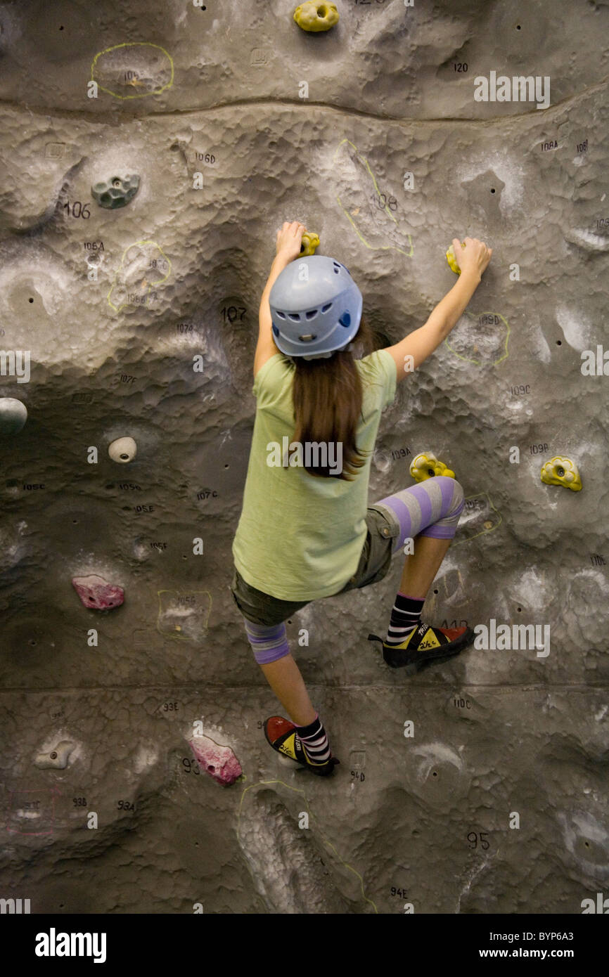Girl on indoor Climbing wall, Mile End - Stock Image