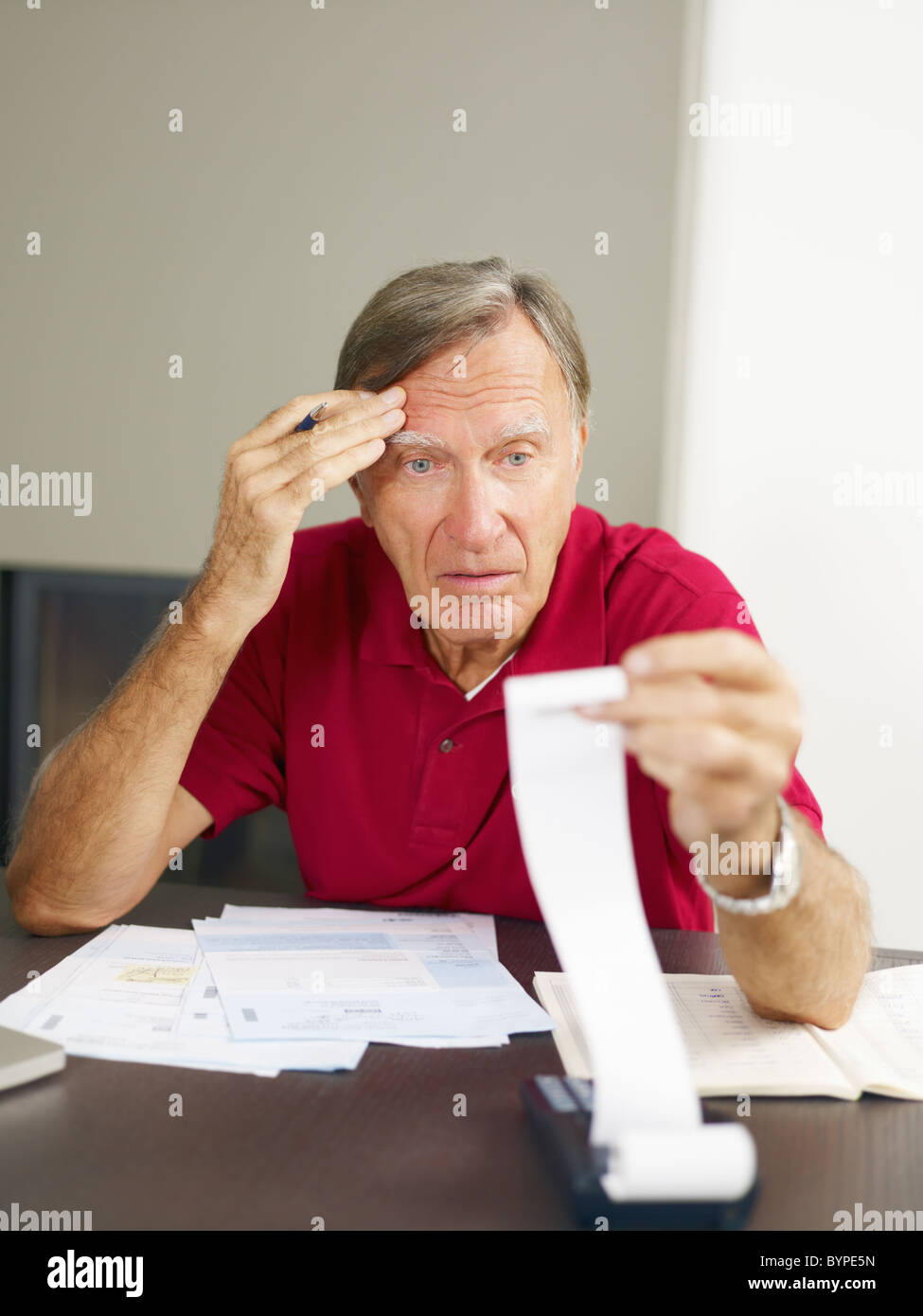 Senior man worried about his home finances. - Stock Image