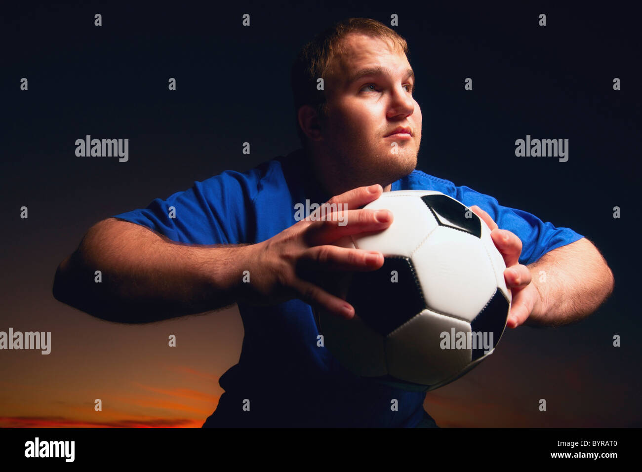 a young man with a soccer ball; wilmar, minnesota, united states of america - Stock Image