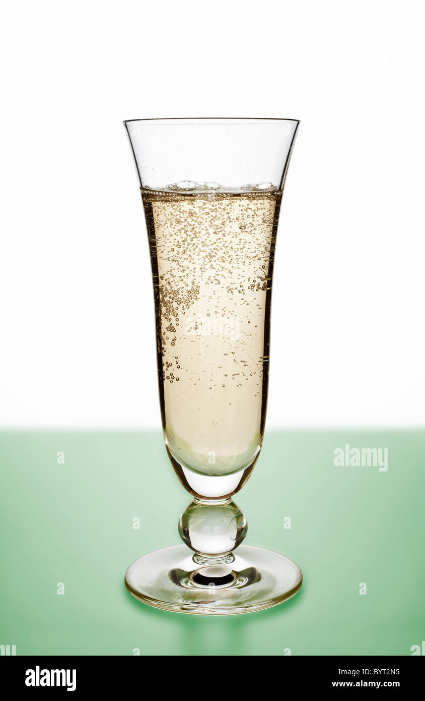 Champagne Glass filled with Champagne - Stock Image
