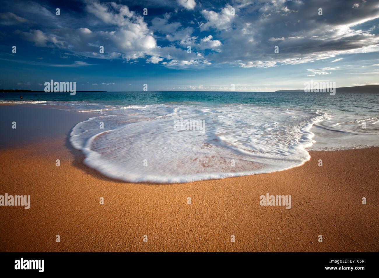 Beach, wave and clouds. Maui, Hawaii. - Stock Image