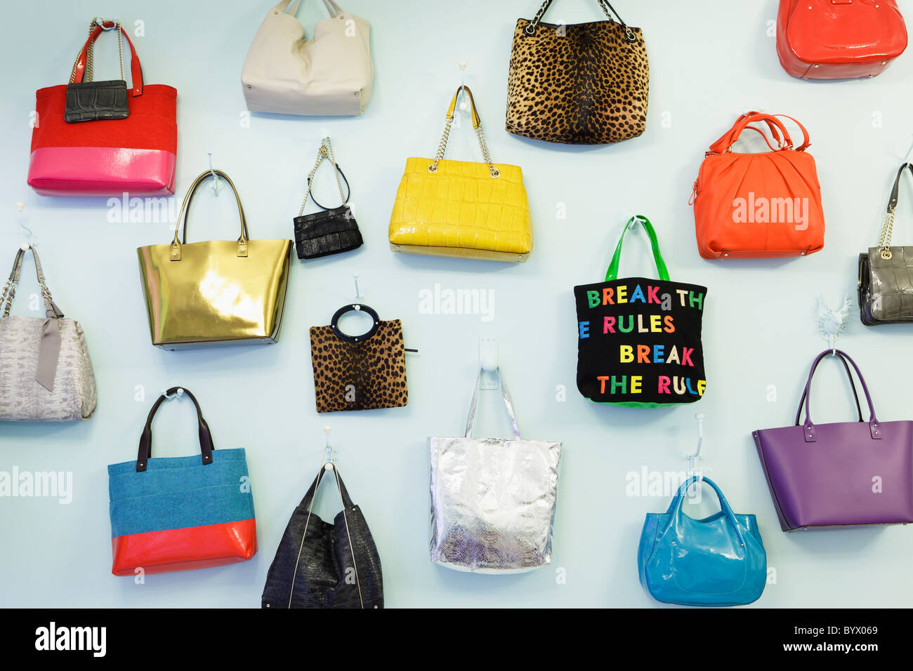A wall of handbags at the Kate Spade pop-up store in Covent Garden, London, England Stock Photo
