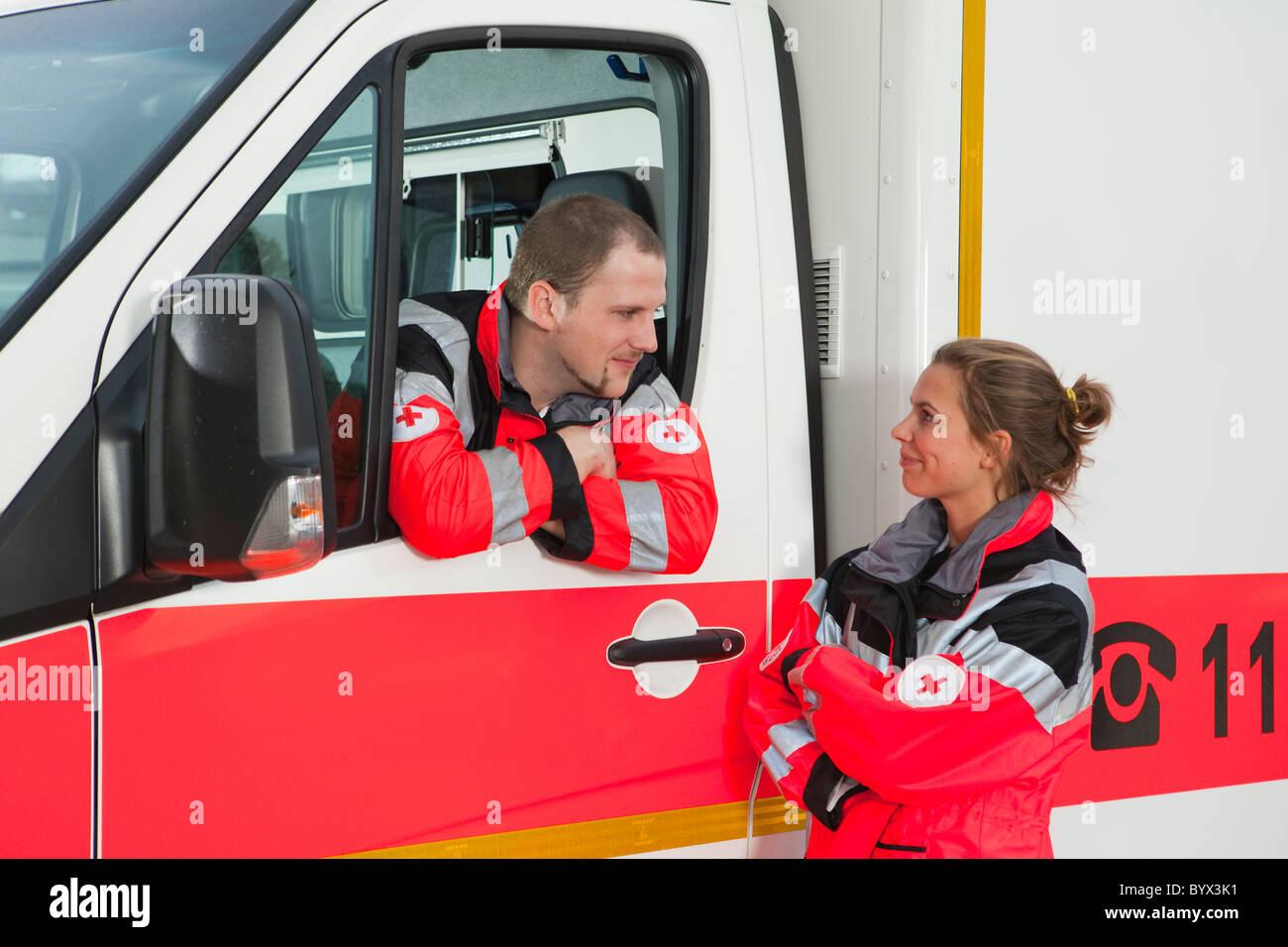 Ambulance man takling to collegue - Stock Image