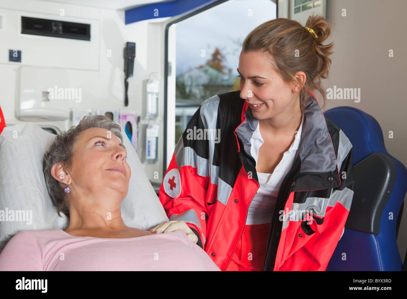 Ambulance woman caring about woman - Stock Image