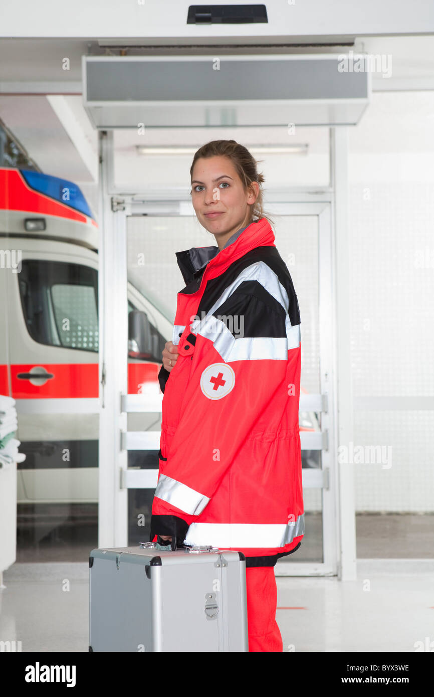 Paramedic girl in hall, smiling - Stock Image