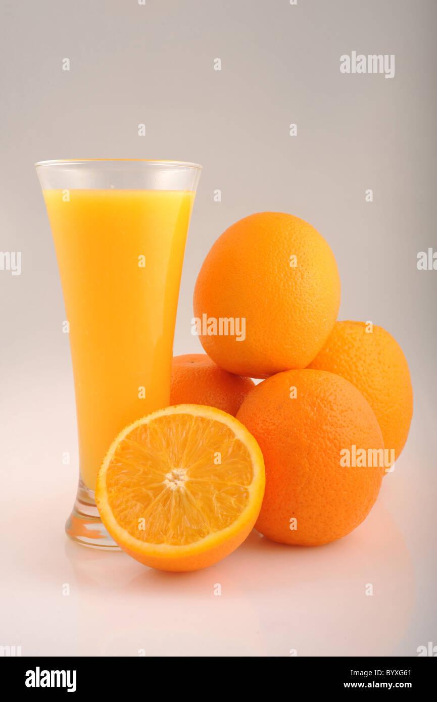 Orange Juice and oranges - Stock Image
