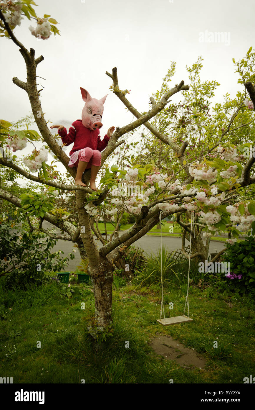 Pigs might fly. Girl in pig mask with wings. - Stock Image